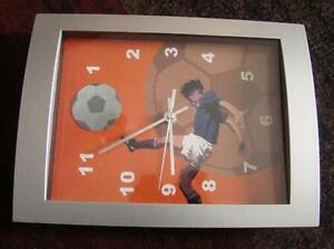A NICE LOOKING & FUNCTIONING SPORTS LIKE CLOCK DECORATIVE SOCCER