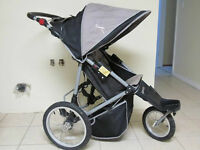 3 wheel beige and black mongoose stroller