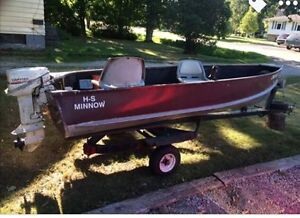 14 foot boat, 9.9 motor and trailer.