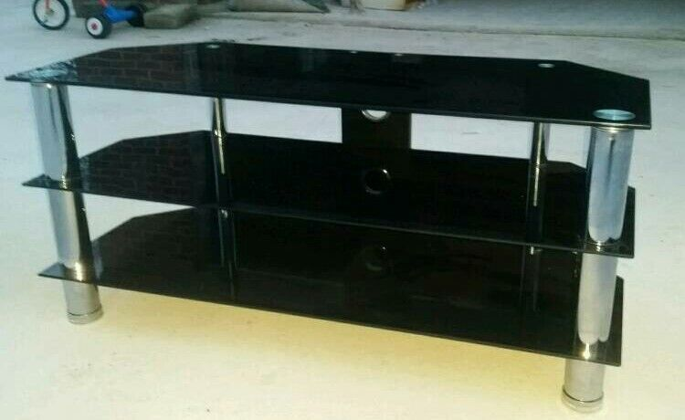 """TV Stand in excellent conditionBlack and Chromein West YorkshireGumtree - For sale is a black glass and chrome TV stand Excellent condition!3 Tier stand which is suitable for TVs up to 50"""". Selling due to redecorating my living room so no longer required. Dimensions are 41"""" Width x 18"""" Depth.Any questions you can..."""
