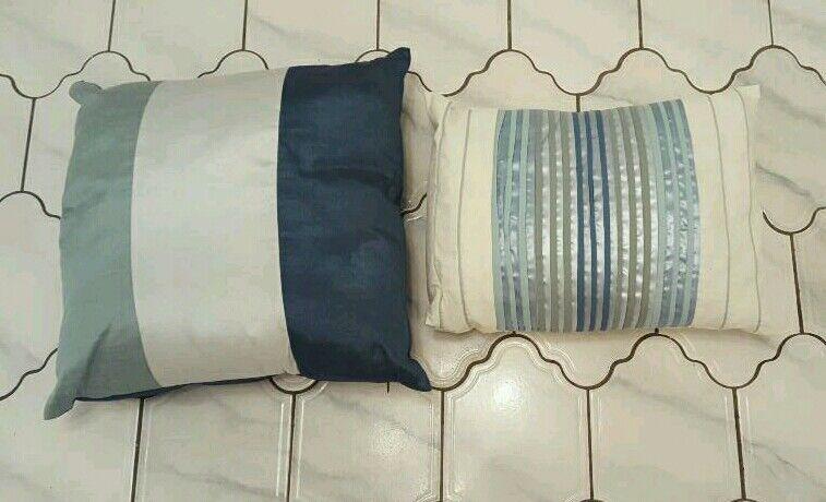 Next teal cushions