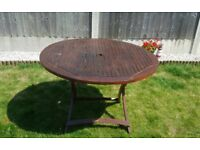 Wooden garden table (circular) and 2 chairs