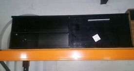 A brand new black 1 door 1 shelve tv unit.