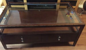 Large solid wood glass top coffee table.