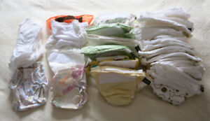 Set of Assorted Kushies cloth diapers and accessories