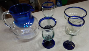 5 piece blue mouth blown glass pitcher and 4 liquor glasses-$30
