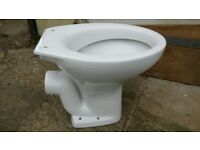White toilet bowl and cistern