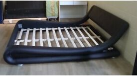 Brown leather low to ground king size bed frame