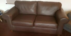 Brown leather look two seater sofa