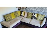 Large 4 seater corner sofa with an assortment of green/black scatter cushions