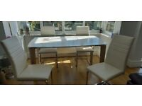 Reduced in price; White dining table and four ceam leather chairs