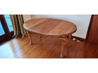 Oval oak dining table with extension leaf