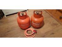 2 x Calor gas bottles. 3.9kg. One 75% full, one 25%.