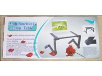 Multifunctional laptop table for sofa, bed, desk use