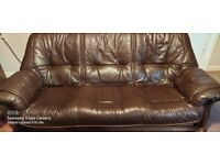 Chocolate brown Leather 3-seater sofa in a set with two armchairs. Good condition.