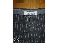 Calvin Klein men's trousers,size M,new without tags-post it