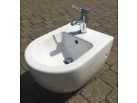 Wallmounted Villeroy & Boch Bidet with Mixer Tap and Pop-Up Waste.
