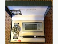 A Watch/Alarm Clock/Pen Set