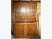 Wooden glass door display cabinet.