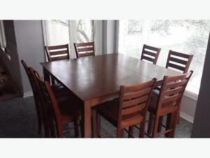 Pub style table and 8 chairs for sale.