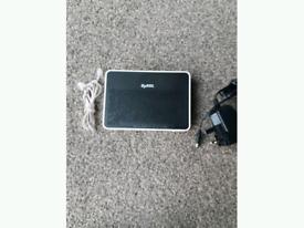 ZyXEL AMG1302-T10B Wireless Router