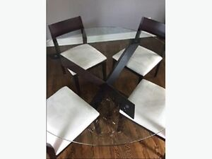 EQ3 circular glass dining table with 4 chairs