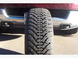 4 235/60/16 goodyear studded tires.