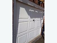Garage door with frame 88 inches wide and 80 inches tall.