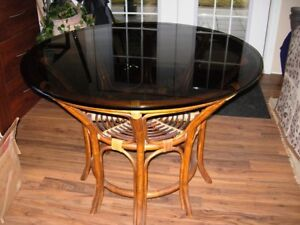 Smoked glass dining table with rattan base