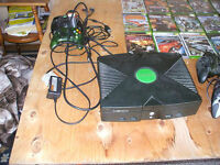 Original XBOX CONSOLE AND 61 Games!!And 27 inch T.V.
