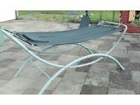 Freestanding garden hammock.