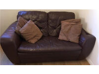 Two seater sofa (brown leather with cushions included)