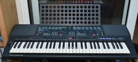 YAMAHA PSR-500 KEYBOARD WITH CASE AND STAND