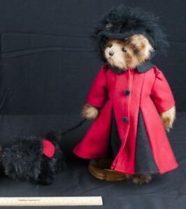 BEAR IS WEARING A BLACK AND RED PETTICOAT WITH A BLACK DOG$25