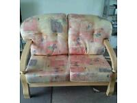 Two seater wooden frame sofa