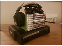 Xbox 360 with controller, 8 games and headset.