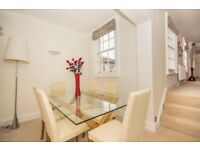 Superbly located & well appointed apartment in this impressive period house with original features