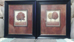 Two nicely framed art prints by James Wiens for upscale office.