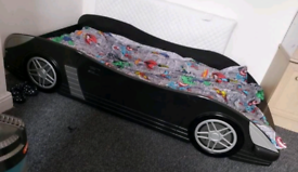 Single car bed with mattress and underneath storage drawer. Delivery a