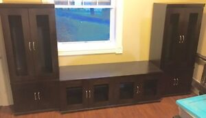 Entertainment unit with side shelving, end tables and lamps