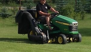 John Deere X500 lawn tractor with snow blower