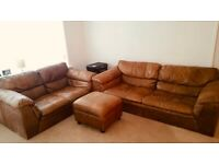 Tan leather sofa with matching pouffe