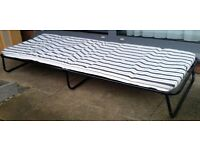 folding guest bed. See photos. 185cm x 68cm. In good condition.