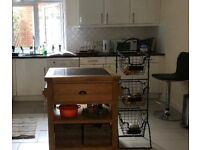 Wood kitchen island with granite top