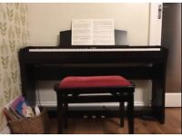 Slightly used electronic keyboard (CL35 KAWAI) equipped with an adjustable stool and beginner books