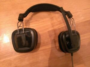 Various Items and Headphones Related To Video Games