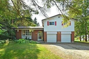 Incredible 22+ acre property and family home in Angus!