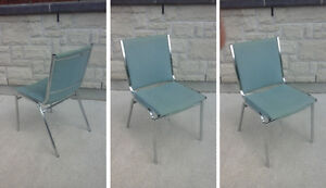Stacking chairs, with chrome legs, some with wooden arm rests