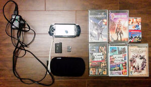 PSP-1001 with Unlocked Firmware + 6 Games + 1 Movie
