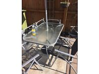 Glass garden table, 6 chairs, parasol and parasol base